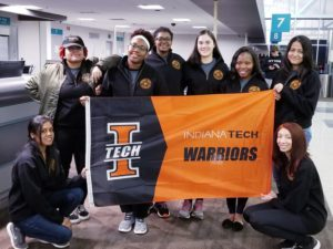 Spring break crew with the Indiana Tech flag.