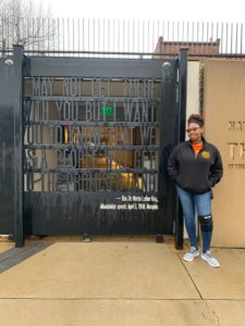 Student standing at the entrance of the National Civil Rights Museum